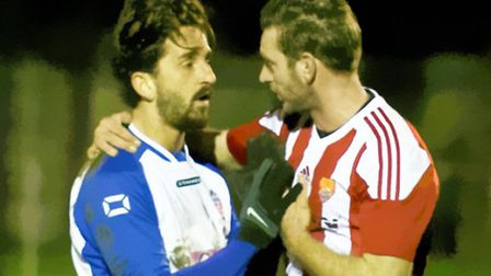 Clacton's Wayne Chapman and Felixstowe's Danny Smy have 'a chat'