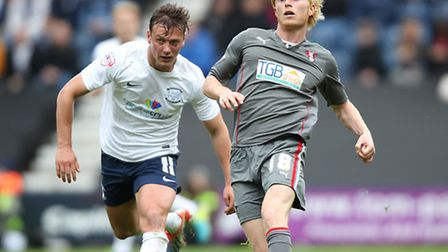 Preston North End's Lee Holmes (left) and Rotherham United's Ben Pringle battle for the ball during