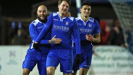 Michael Spillane of Lowestoft Town (centre) is congratulated by team mate, Chris Henderson after sco