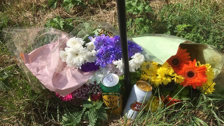 Floral tributes laid where a cyclist Kenneth Cobourne was killed in an accident on the B1077 between