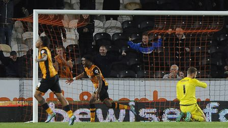 Chuba Akpom celebrates Hull's second goal just before half-time in their 3-0 win over Ipswich