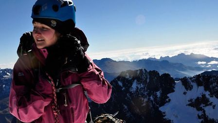 Lucy on the summit of a 6000m peak in Bolivia