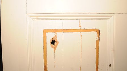 Image released by Essex Police showing the door that was shot through by burglars in Sible Hedingham