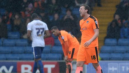 Tom Eastman expresses his frustration as he is sent off at Gigg Lane during the first half against B