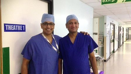Surgeons Tan Arulampalam (left) and Raj Rajaganeshan are pictured in main theatres, Colchester Gener