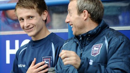 Lee Bowyer and Byron Lawrence talk on the bench in 2012