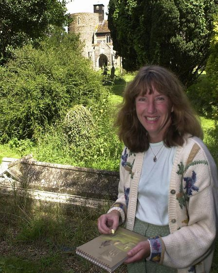 Sue Heaser, who has editedf the new book, by the graveside of Rev Richard Cobbold. Picture: Jamie