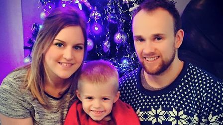 Bradley Wood, pictured with his girlfriend Karina Youngs and their son Lucas.
