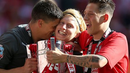 Ben Pringle (centre) celebrates League One play-off victory at Rotherham