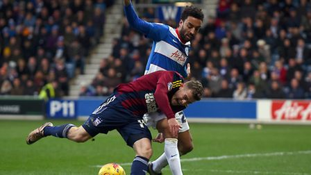 Ryan Fraser tussles with James Perch at QPR