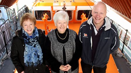 Sandra Saint (centre), who has been honoured by the RNLI with a Gold Badge. Pictured with Veda Crane