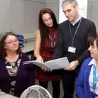 Hannah English and Steve Mcintosh show outpatient department colleagues plans for the area.