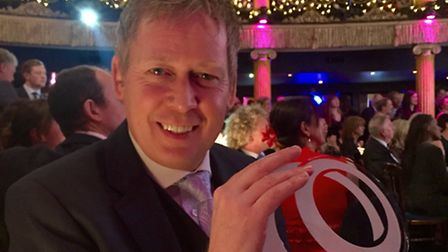 Rob Neill of The Groom's Room with the company's latest trophy at The Wedding Industry Awards.