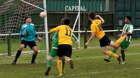 Mildenhall's David Lampshire (no 10) heads the first Mildenhall goal