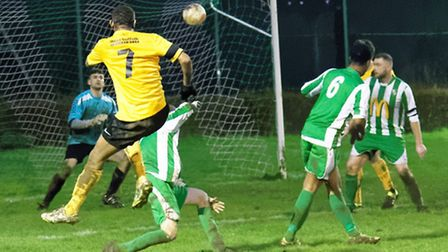 Kevin Enaro drives home the fifth and final Mildenhall goal