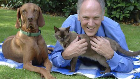 Behaviourist Roger Tabor with a dog and cat. 'One is not better than the other,' he says