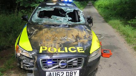 Undated handout photo issued by Norfolk Police of damage caused to one of their patrol cars after a