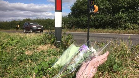 Floral tributes to Kenneth Cobourne where he died on series of bends on a 60mph section of the B1077
