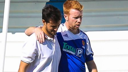 Shane Wardley is helped from the pitch after being substituted eleven minutes into the Ipswich Wande