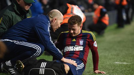 Ryan Fraser being tended to by club Physio Matt Byard on the sideline at the end of the QPR match