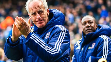 Town manager Mick McCarthy applauds the fans as he comes on the pitch with assistant Terry Connor ah
