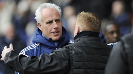 Mick McCarthy gets a hug from Bolton Manager Neil Lennon before kick-off on Saturday