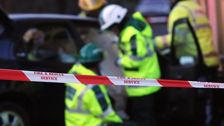 A file picture of emergency services working at the scene of a crash.