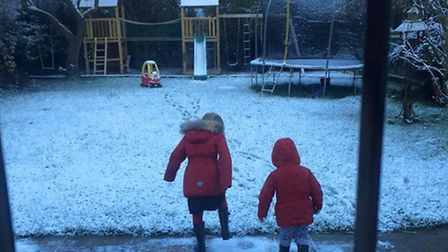 Izzy and Aiden playing in the snow in their garden in Lowestoft