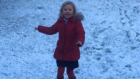 Izzy playing in the snow in their garden in Lowestoft