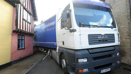 The scene in Woolpit after a lorry got stuck after hitting a building on a narrow street.
