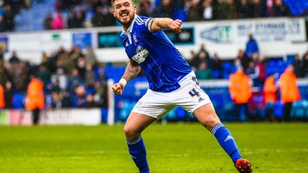 A fist pumping Luke Chambers celebrates an Ipswich win after the Ipswich Town v Nottingham Forest (C