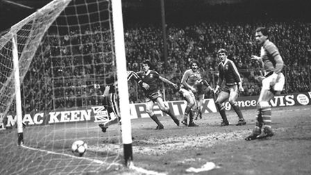 Ipswich Town striker Paul Mariner watches his header go in as he equalises against St Etienne in the