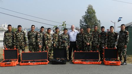 Station Officer Steve Hart with soldiers from the Nepalese Disaster Recovery Regiment. Photo: ECFRS