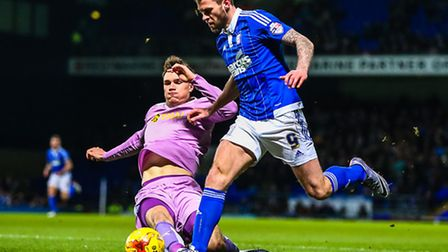 Reading's Jake Cooper concedes a corner to halt the run of Daryl Murphy in the first half of the Ips