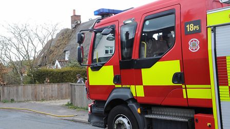 A fence caught fire in Bury St Edmunds. Stock image.