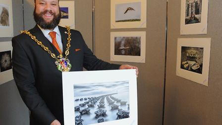 The Mayor of Ipswich Glen Chisholm holds the print he selected as his favourite image at the Ipswich