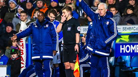 Town manager Mick McCarthy and his assistant Terry Connor signal to bring on super sub Brett Pitman