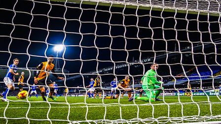 Daryl Murphy watches as his effort comes off the inside of the post and rolls along the face of the