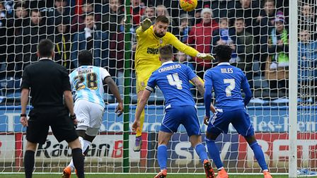 Bartosz Bialkowski makes an instinctive save as the ball flicks off the head of Luke Chambers at Hud