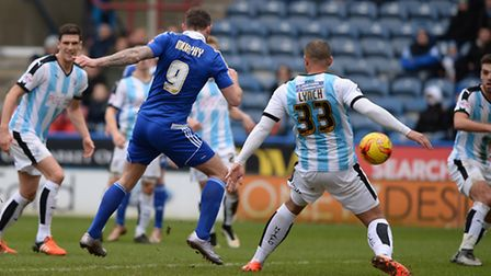 Daryl Murphy improvises a late first half shot which goes just wide at Huddersfield