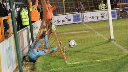 Kidderminster keeper Dean Snedker falls into his own net after failing to stop a wonder strike from