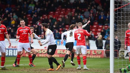 Alex Gilbey wheels away after putting Colchester in front just before half-time at Walsall