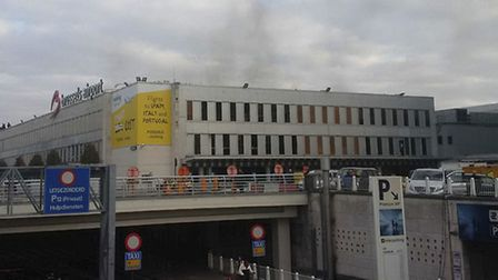 In this image provided by Daniela Schwarzer, smoke is seen at Brussels airport, after explosions wer