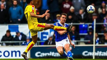 Jonas Knudsen drives the ball down the line as Grant Ward tries to block during the Ipswich Town v R