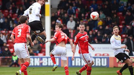 Alex Gilbey puts Colchester in front just before half-time at Walsall