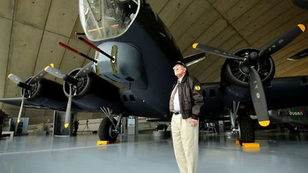 USAAF serviceman William Toombes stands alongside a USAAF B17 aircraft at the American Air Museum in