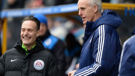 Mick McCarthy shares a smile with the fourth official before the game on Saturday at Huddersfield
