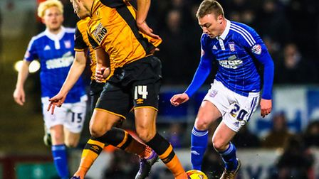 Freddie Sears skips past Jake Livermore during the Ipswich Town v Hull City (Championship) match at