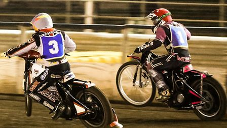 Heat one action as former Witch Scott Nicholls tries the inside run on Carl Wilkinson, but couldn't