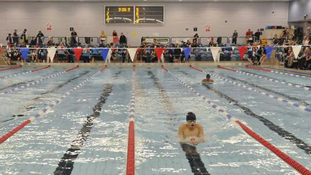 Swimmers compete in the 400m individual medley finals at the Suffolk County Swimming Championships a